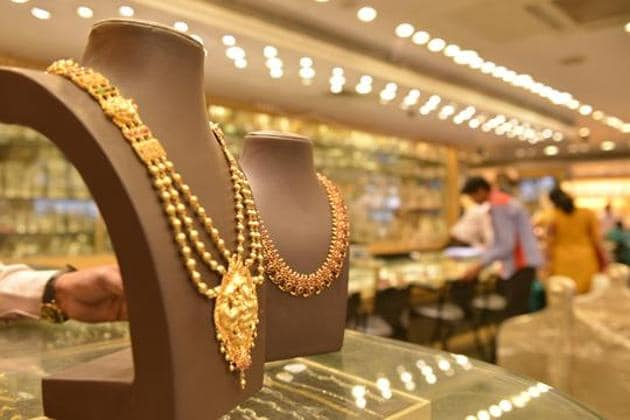 According to jewellers, the introduction of GST at 3% on gold and 18% on making charges has led to a hike in gold jewellery price.(HT File Photo)