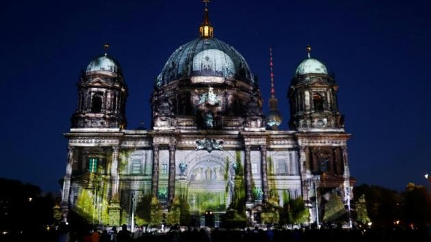 <p>The Berlin Cathedral is seen illuminated during the Festival of Lights in Germany. This ten-day event,  which concluded on October 15, transformed Berlin...