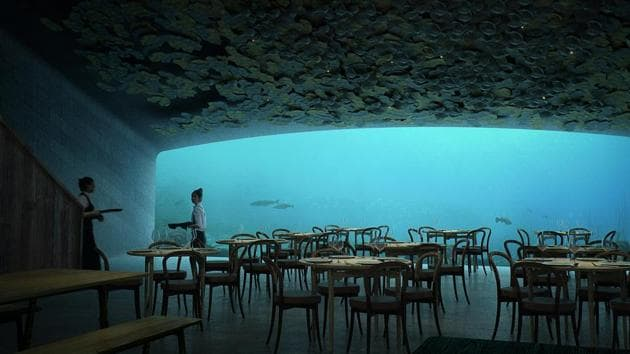 The concrete grey box design features a restaurant for up to 100 guests, with a front-facing 11 x 4m panoramic glass panel giving a view into the depths beyond.(AFP)