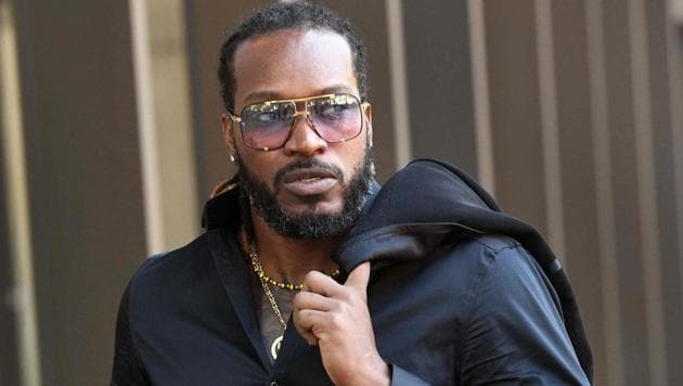 "Chris Gayle arrives at the New South Wales Supreme Court in Sydney on Wednesday. Massage therapist Leanne Russell said she ""cried uncontrollably"" after the West Indies cricketer allegedly exposed himself to her.(AFP)"