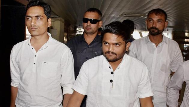 Patidar Anamat Andolan Samiti convener Hardik Patel arrives at detection of crime branch (DCB) police station in Surat on March 2, 2017.(PTI File Photo)