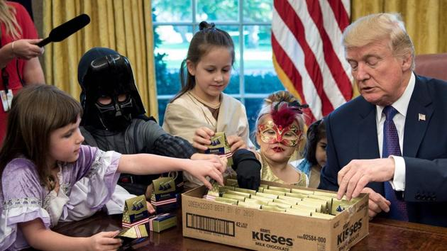 US President Donald Trump meets with children of members of the press for Halloween in the Oval Office of the White House in Washington, DC, on October 27, 2017.(AFP)