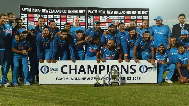Indian cricket team members celebrate after winning the ODI series against New Zealand 2-1 in Kanpur on Sunday.(AFP)