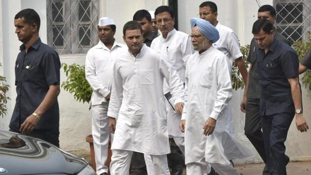 Congress vice president Rahul Gandhi with former prime minister Manmohan Singh, Randeep Surjewala and other leaders leaves after a meeting regarding the party's November 8 protest against demonetisation, at AICC headquarters in New Delhi on Monday(Arvind Yadav / HT PHOTO)