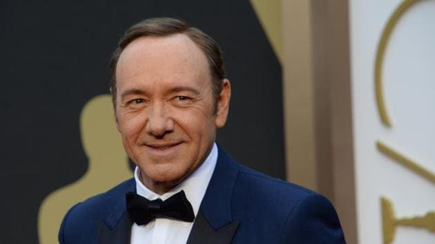 This file photo taken on March 02, 2014 shows actor Kevin Spacey arriving on the red carpet for the 86th Academy Awards in Hollywood, California. Actor Anthony Rapp accused Kevin Spacey of a sexual advance in 1986 when Spacey was 26 and Rapp only 14.(AFP)