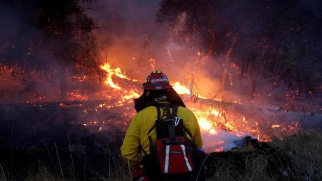 Firefighters battle a wildfire near Santa Rosa, California, US.(Reuters)