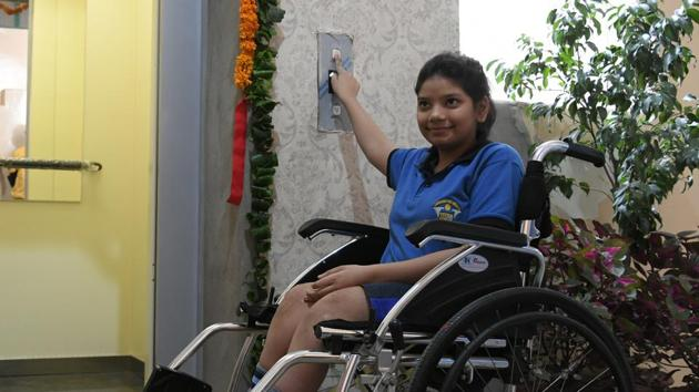 Vasu Bansal, a differently-abled Class 8th student, inaugurating lift at Vivek High School Sector 70 Mohali, on Tuesday.(Karun Sharma)