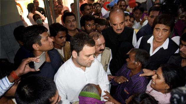 Congress vice-president Rahul Gandhi meets with the family members of victims of Unchahar NTPC boiler blast in Rae Bareli on Thursday.(PTI)