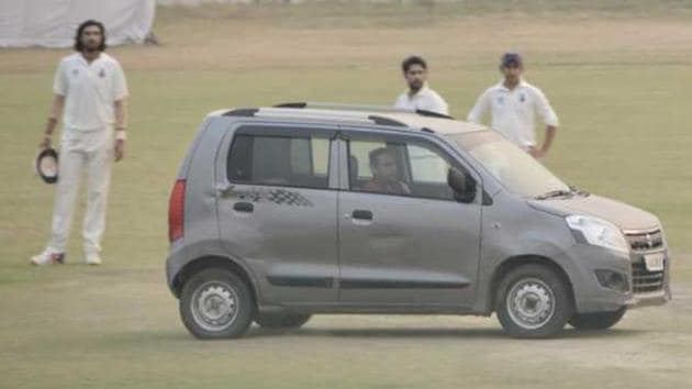 The car was drivern into the middle of the ground during the Ranji Trophy game between Delhi and Uttar Pradesh.(Kamesh Srinivsan/The Hindu)