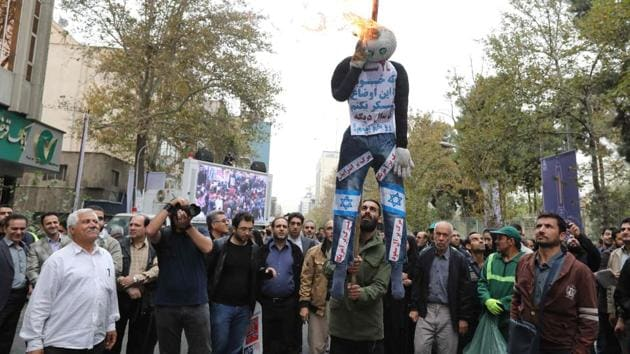 Iranians burn a doll representing Israel and America during a demonstration outside the former US embassy in the Iranian capital Tehran on November 4, 2017, marking the anniversary of its storming by student protesters that triggered a hostage crisis in 1979.(AFP)