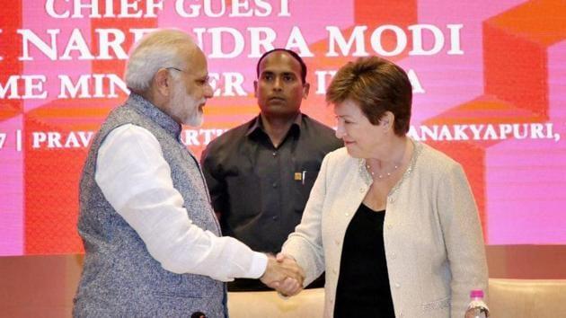 Prime Minister Narendra Modi shakes hands World Bank CEO Kristalina Georgieva at a session on India's Business Reforms, at the Pravasi Bhartiya Kendra in New Delhi.(PTI Photo)