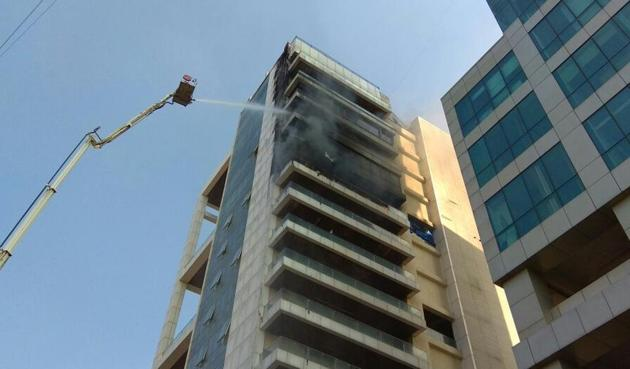 Fire broke out on the 10th floor of Arunachal Bhavan, Vashi, and spread up to the 14th floor on Monday.(Bachchan Kumar)