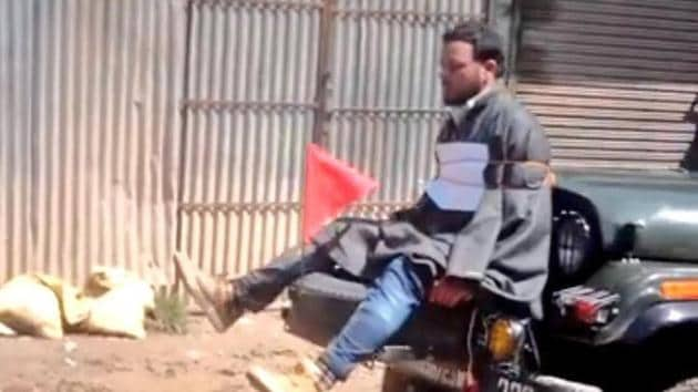 A screengrab of a video showing Farooq Ahmed Dar tied to a jeep as a 'human shield' against protesters.The video had triggered outrage in Kashmir.(Twitter)