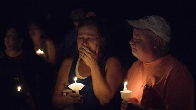 Mourners participate in a candlelight vigil for the victims of a fatal shooting at the First Baptist Church of Sutherland Springs, in Sutherland Springs, Texas. A man dressed in black tactical-style gear and armed with an assault rifle opened fire inside the church in the small South Texas community, killing at least 26.(AP Photo)