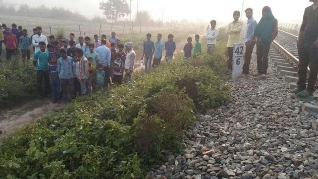People gather near the railway track in Maigalganj where Afrin Khatoon's body was found on October 25.(HT File Photo)