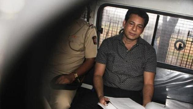 Abu Salem being taken from court in a police van in 2015.(HT File Photo)