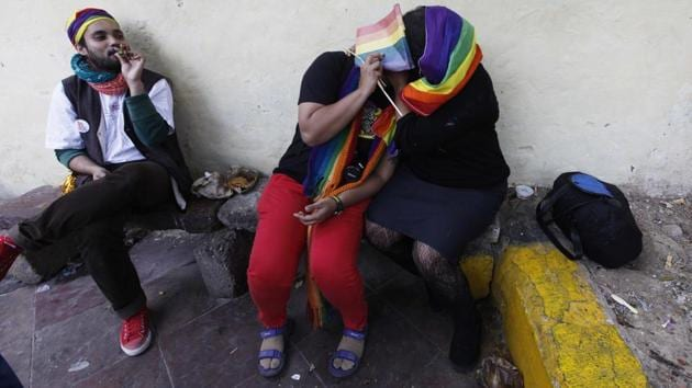 A light moment from the 2012 Pride march in New Delhi as participants take a break. (Virendra Singh Gosain / HT Photo)