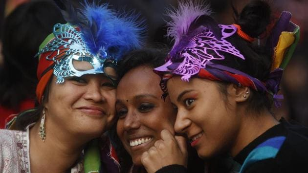 Three participants pose during the 2013 Delhi Queer Pride march. The parade is a yearly festival, held on the last Sunday of November, to honour and celebrate lesbian, gay, bisexual, transgender, intersex and many gender and sexual non-conforming people, and their supporters. (Sanjeev Verma / HT Photo)