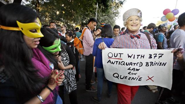 A participant holds a placard and wears a mask bearing the image of Queen Elizabeth II during the Pride march in 2014. India never criminalised homosexuality and gay sex in the past. It was the English who criminalised it but India has failed to strike off Section 377 from its constitution. (Arun Sharma / HT Photo)