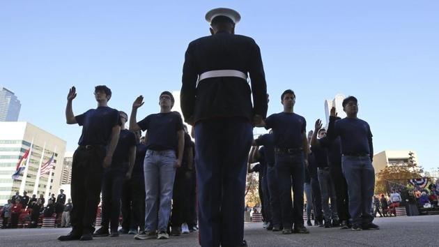 US Marine recruits take the Oath of Enlistment before the start of a Veterans Day parade in Dallas, Friday, Nov. 10, 2017.(AP)