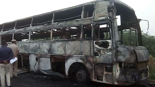 Charred remains of a Rajasthan State Road Transport Corporation bus that caught fire on way to Barmer from Jaipur on Sunday morning killing a 25-year-old woman and her two-year-old daughter.(HT Photo)