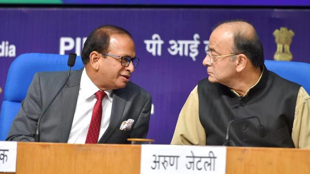 Minister of finance and corporate affairs, Arun Jaitley with DIPP Secretary Ramesh Abhishek at a press conference on India's ranking in the World Bank's Ease of Doing Business Report 2018(PTI)