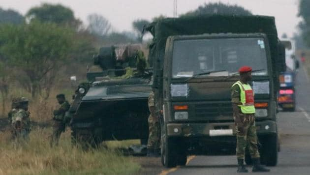 Soldiers stand beside military vehicles just outside Harare, Zimbabwe.(Reuters Photo)
