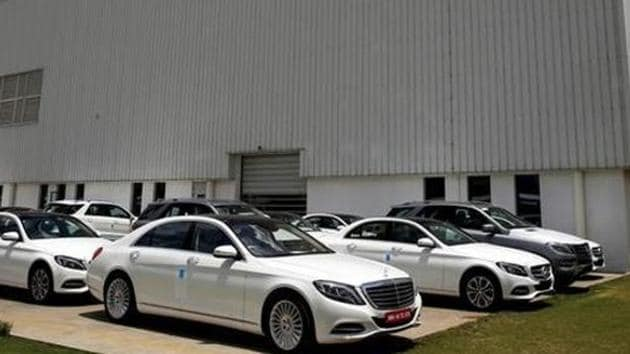 Different car models of Mercedes-Benz are parked at the company's vehicle assembly plant in Chakan, outside Pune.