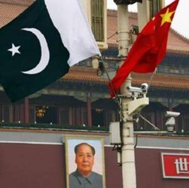 The Pakistani and Chinese national flags fly in front of the portrait of Chairman Mao Zedong at Beijing's Tiananmen Square.(Reuters File)