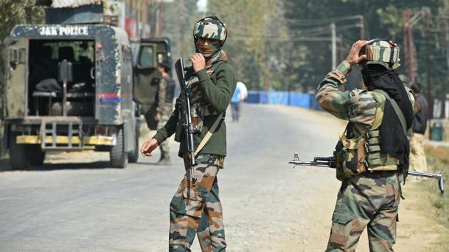 Paramilitary troopers stands guard after a gunfight with militants at Hajin village of Kashmir's Bandipora district, north of Srinagar, on October 11, 2017.(AFP File Photo)