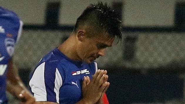 <p>Bengaluru FC captain Sunil Chhetri celebrates after scoring against Mumbai City FC in an Indian Super League match.</p> (ISL / SPORTZPICS)