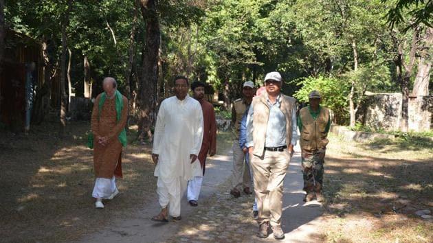 Anand Srivastava, a trustee of the Maharishi Yogi Trust (2nd from L) with Rajaji Tiger Reserve director Sanatan Sonkar(2nd from R) at the ashram in Rishikesh.(HT Photo)
