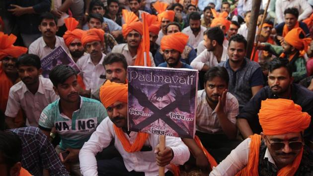 Members of Rajput groups hold placards as they protest against the release of Bollywood film Padmavati in Mumbai, India.(AP)