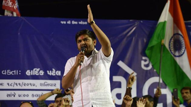 Hardik Patel (C), leader of Patidar Anamat Andolan Samiti (PAAS), addresses a gathering with his supporters during 'Adhikar Sammelan' at Mansa, some 50 km from Ahmedabad.(AFP File Photo)