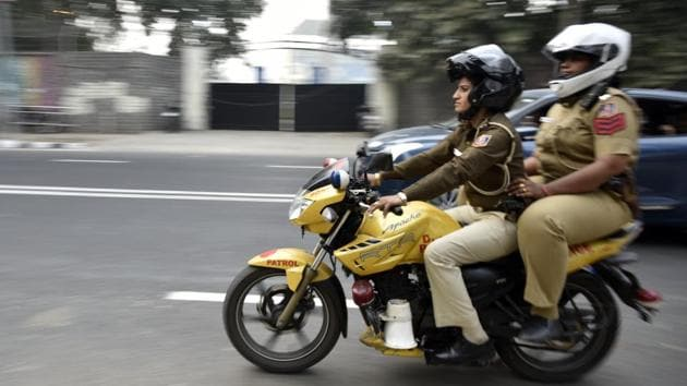 Delhi policewomen ride a motorcycle as they patrol north campus area on Sunday.(Ravi Choudhary/HT Photo)