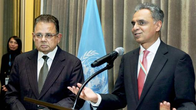 India's permanent representative to the United Nations, Syed Akbaruddin, speaks during a reception in honour of Dalveer Bhandari (left) at the UN in New York on November 20, 2017. Bhandari won the votes in the UN General Assembly to make it to the International Court of Justice after the UK pulled out of the race.(PTI)