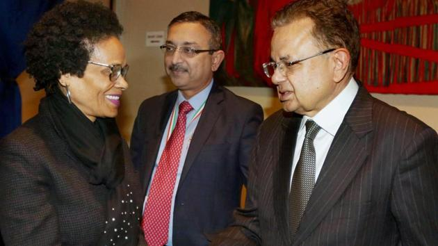 Justice Dalveer Bhandari (right) is greeted during a reception organised in his honour at the United Nations in New York on Monday.(PTI)