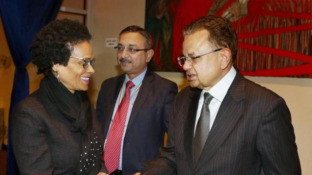India's Justice Dalveer Bhandari being greeted during a reception organised in his honour at the United Nations in New York on Monday.(PTI Photo)