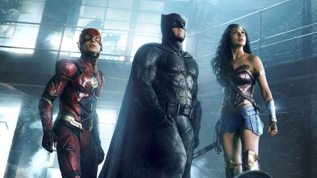 This image released by Warner Bros. Pictures shows Ezra Miller, from left, Ben Affleck and Gal Gadot in a scene from Justice League.(AP)