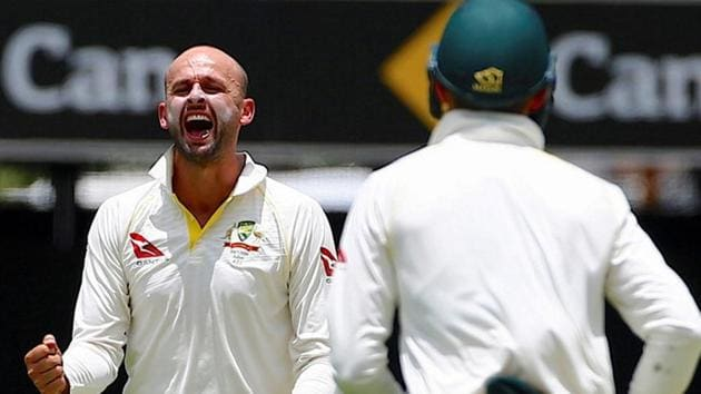 Nathan Lyon celebrates with team mates after dismissing Chris Woakes during the first Ashes 2017-18 Test between Australia and England in Brisbane.(REUTERS)