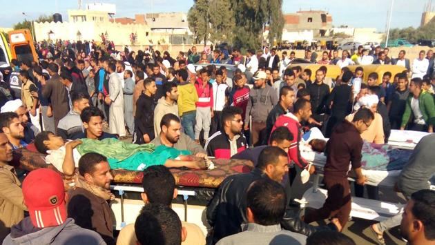 Egyptians carry victims on stretchers following an attack on a mosque near the North Sinai, on Friday.(AFP Photo)