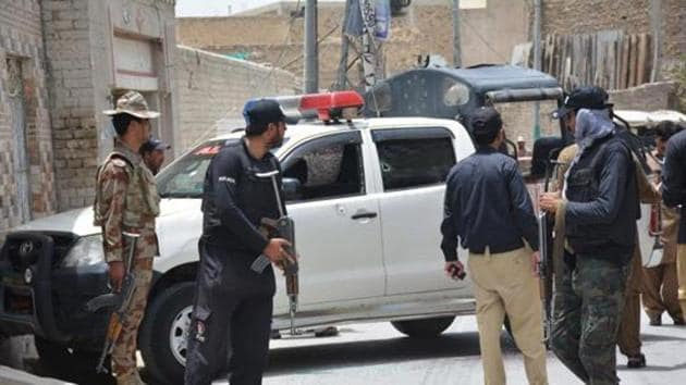 Pakistani security personnel stand next to a police vehicle after an ambush by gunmen in Quetta on July 13.(AFP File Photo/Representative image)