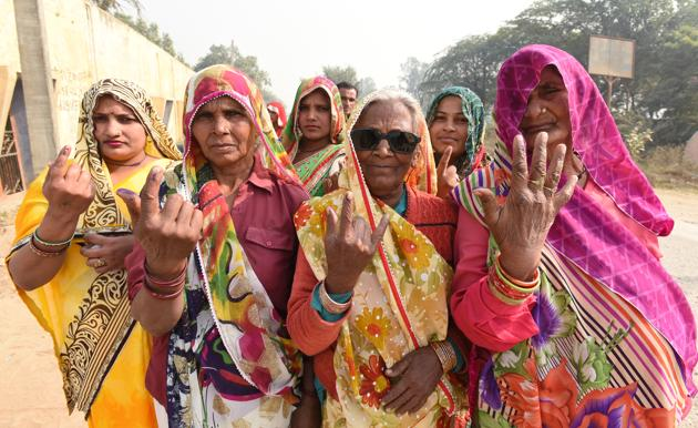 Women of Rabupura show their inked fingers after casting their votes on Sunday.(Virendra Singh Gosain/HT PHOTO)