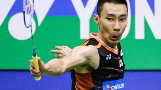 Malaysia's Lee Chong Wei hits a shot against China's Chen Long during the men's singles final at the Hong Kong Open badminton tournament in on Sunday.(AFP)