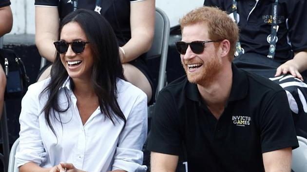 Britain's Prince Harry and his girlfriend actress Meghan Markle watch the wheelchair tennis event during the Invictus Games in Toronto, Ontario, Canada September 25, 2017.(Reuters File Photo)