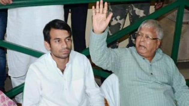 RJD's Tej Pratap with his father Lalu Prasad.(PTI file)