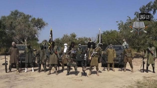 In this file image taken from video released by Boko Haram, Abubakar Shekau, (C), the leader of Nigeria's Islamic extremist group, is seen surrounded by his fighters.(AP file)