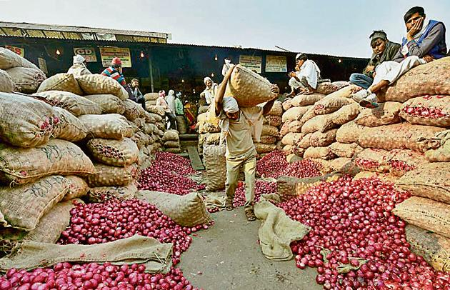 Heap of onion sacks at Azadpur vegetable market in New Delhi. Retail onion prices have touched Rs 80 per kg in the national capital.(PTI Photo)