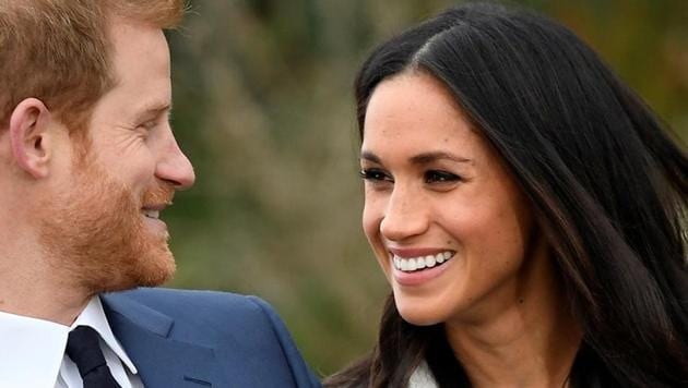 Britain's Prince Harry poses with Meghan Markle in the Sunken Garden of Kensington Palace, London.(REUTERS)