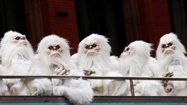 """Actors dressed as a 'Yeti' ride aboard a tour bus during a promotional event for Travel Channel's """"Expedition Unknown: Hunt for the Yeti"""" in Manhattan, New York City.(Reuters File Photo)"""